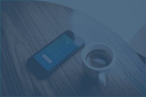 Phone with Twitter and a cup of Coffe